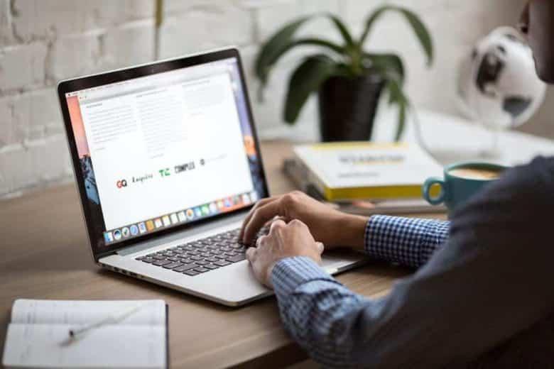 man-using-macbook-air-e1563276547367